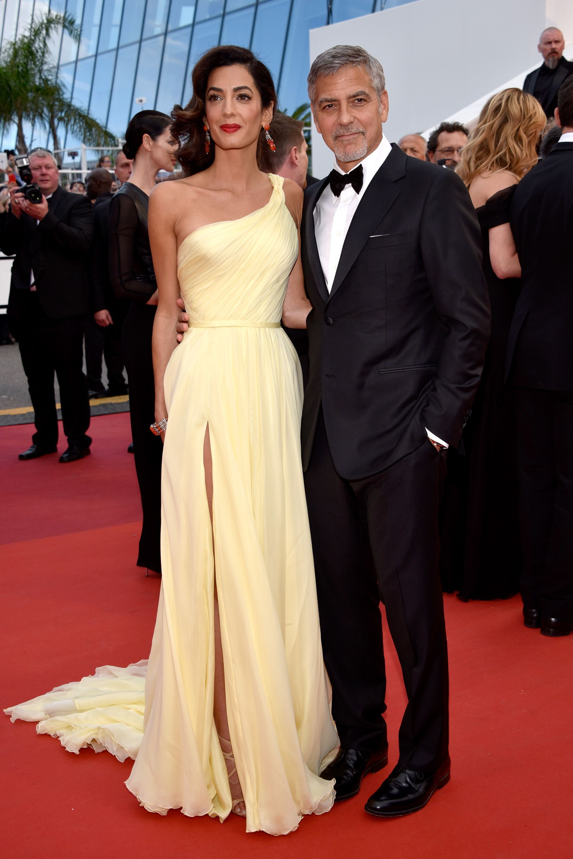 2016 Cannes - George and wife Amal Clooney in yellow Atelier Versace at