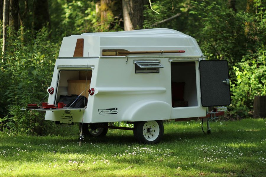 Tiny camper with roof mounted row boat by american dream for Tiny camping trailers