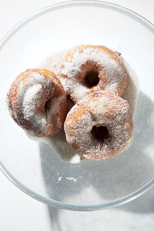 The addition of mashed potatoes to the dough gives these donuts their signature pillowy texture. Lightly spiced with mace and lemon and tossed in a mixture of sugar and black pepper, these little treats are revelatory.