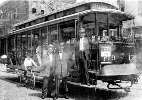 George Dundee, standing on the step of one of Galveston's original trolleys, worked as a motorman for the Galveston streetcar lines in the early 1900s. / handout
