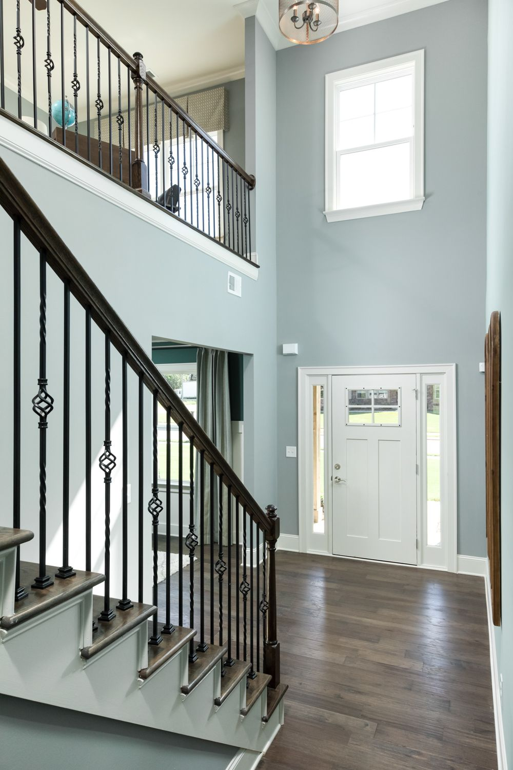 Two Story Entryway In The Abaco Home Plan The Loft Above Is Open To The Foyer Below Creating A Grand Entrance Into New Homes Foyer Design Building A New Home