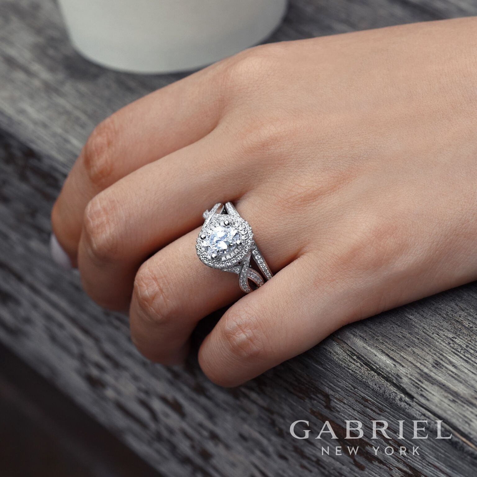 We Love this oval double halo twist engagement ring