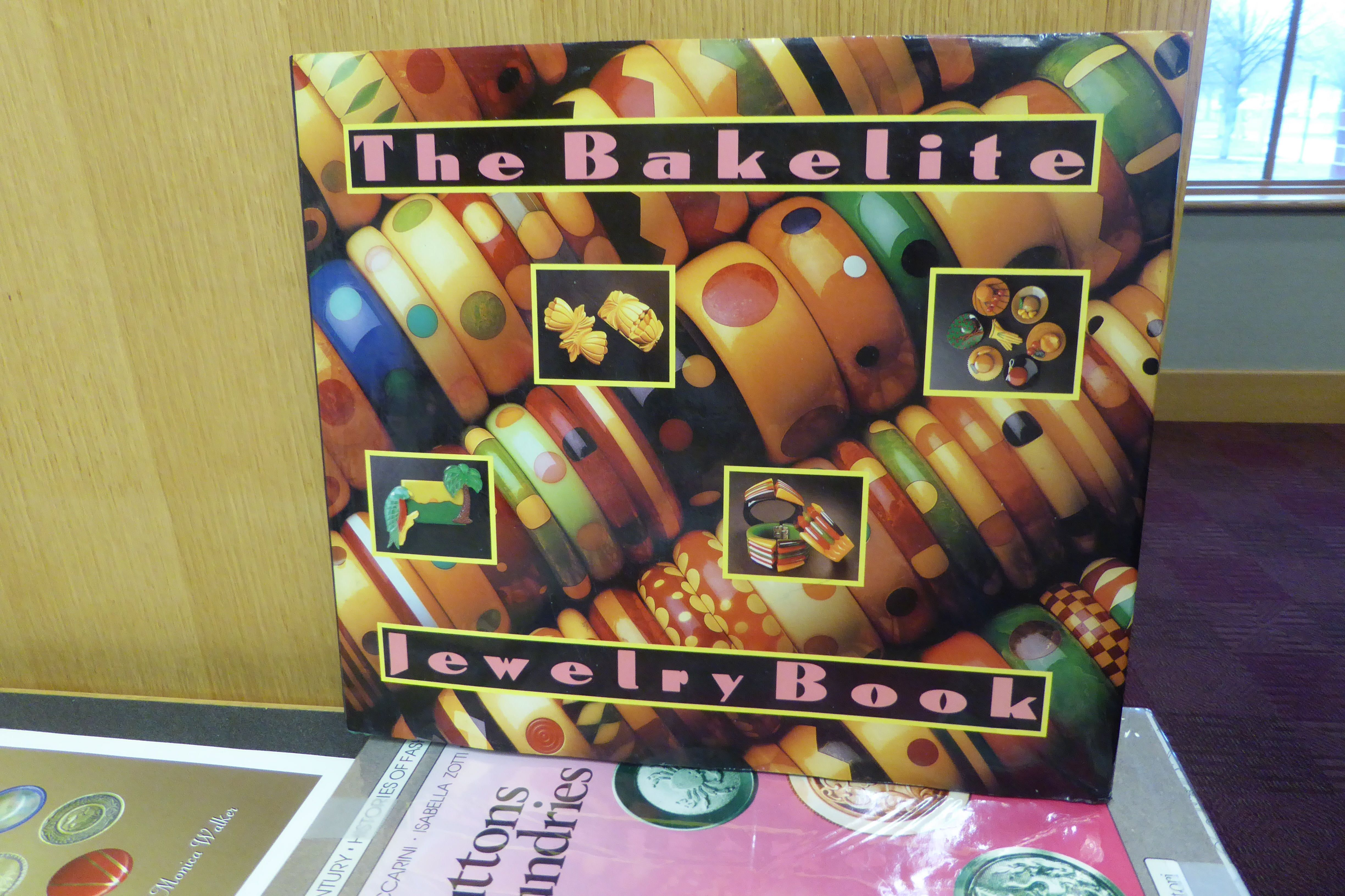 The Bakelite Jewelry Book by Corinne Davidov.  During recent years, the Bakelite jewelry of the 1930s has become a trendy and popular fashion accessory and much-valued collectible. The authors have assembled here the greatest array ever seen of Bakelite jewelry. 160 illustrations, 150 in color.