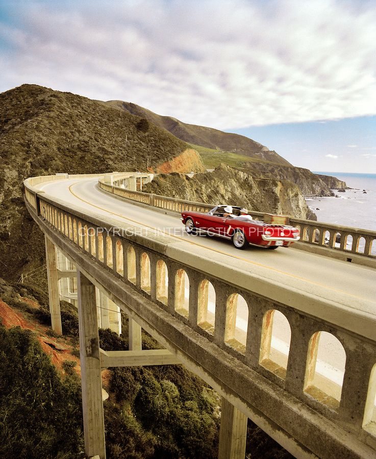 USA, California, Big Sur, couple in a 1965 Mustang on a road trip