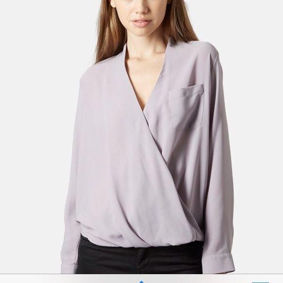 99fd39d079f3d0 Top shop surplice pocket blouse Topshop surplice pocket blouse in size 4  purplish grey color. Has been worn twice Topshop Tops Blouses