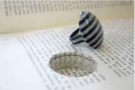 Jeremy May of Littlefly jewelry makes rings from books. Littlefly jewelry is made by laminating hundreds sheets of paper together, then carefully finishing to a high gloss. The paper is selected and carefully removed from a book, and the jewellery re-inserted in the excavated space.