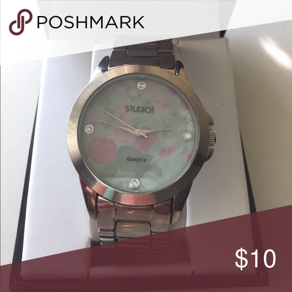 Mint Green Floral Face Watch Never used. Silver with mint green and light pink floral pattern face. Can be sized as no links are taken out currently. Studio Time Accessories Watches