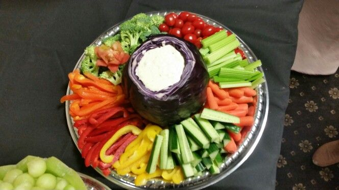 veggie platter using a cabbage as a dip bowl