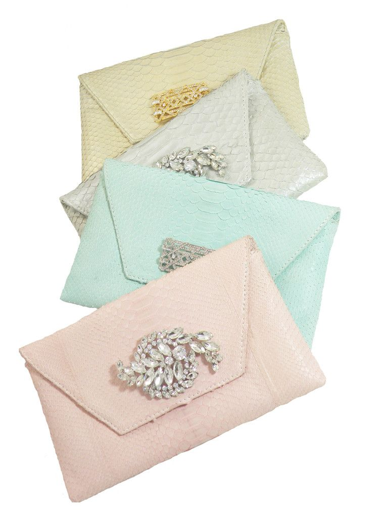 Pastel bridal and bridesmaid clutches with detachable brooches on Merci New York