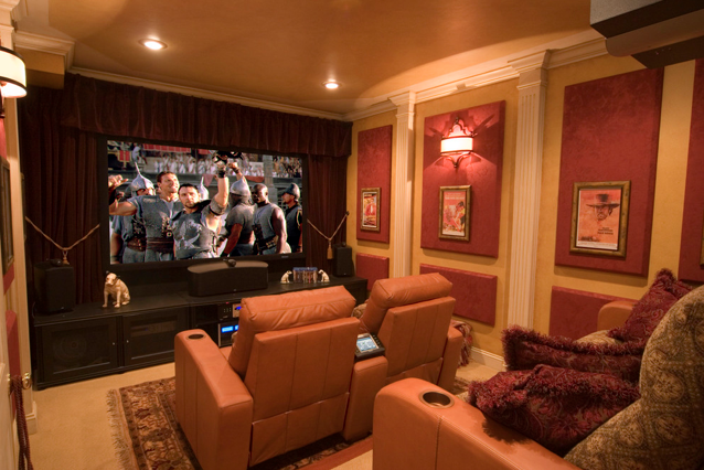 Orange home theater with yellow accents. www.homecontrols.com | Home on home audio designs, theatre room designs, custom media wall designs, exercise room designs, home art designs, best home theater designs, exclusive custom home theater designs, great home theater designs, home salon designs, home brewery designs, fireplace designs, tools designs, lounge suites designs, easy home theater designs, small theater room designs, home reception designs, living room designs, home renovation designs, home cooking designs, home business designs,