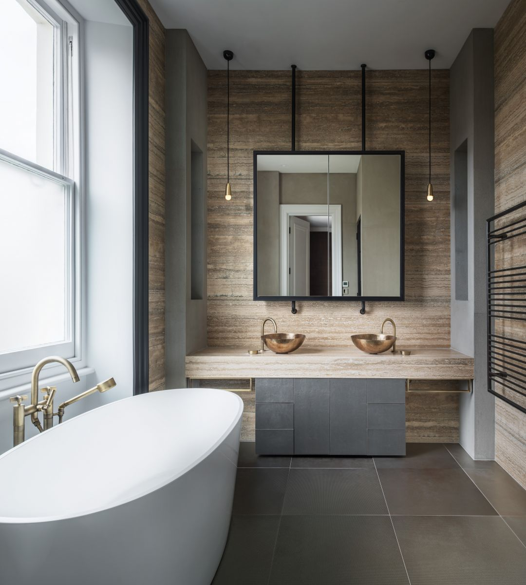 """The London bathroom shown here is by interior designer Roselind Wilson. It features taps by The Watermark Collection as part of a look she's described as """"sophisticated-industrial"""". The taps, from the 'Zen' and 'London' collections, are in a Vintage Brass finish and share an architectural simplicity of form thewatermarkcollection.eu"""