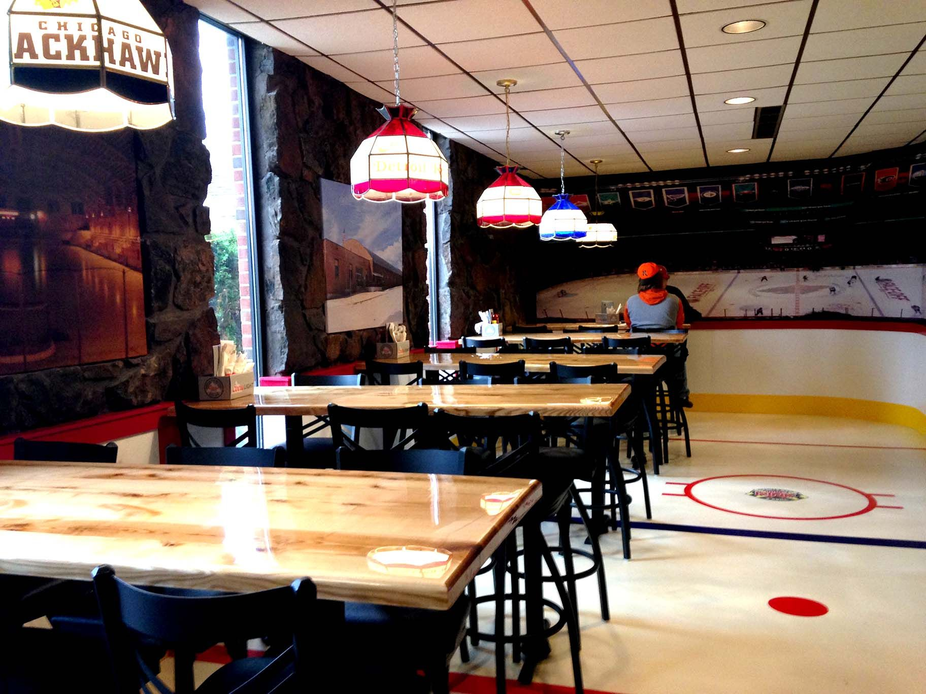 With A Floor Designed To Look Like A Sheet Of Ice In A Hockey Arena The Rink Sports Bar And Grill Features Hockey Themed A Floor Design Bar Areas Hockey Arena