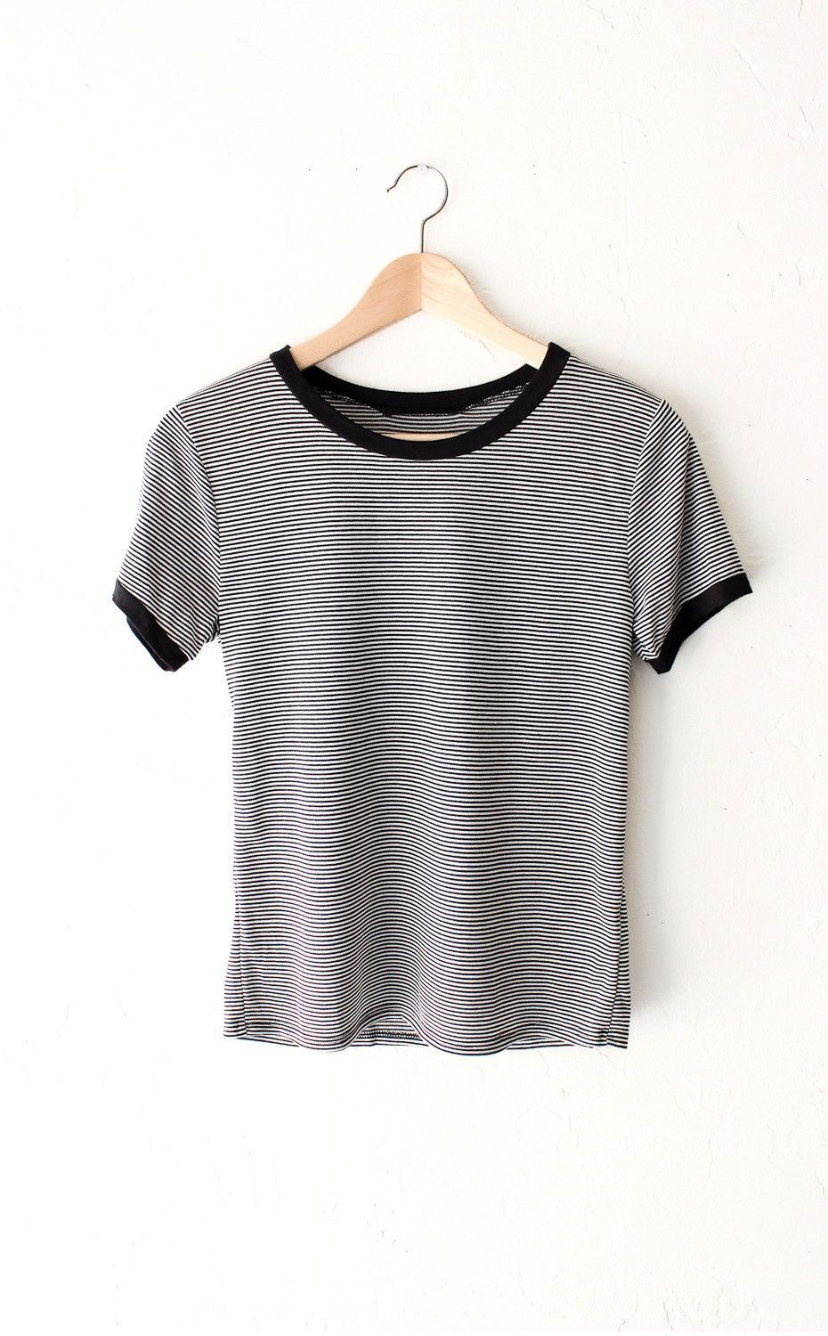 """- Description Details: Soft & short sleeve ringer tee with all over horizontal stripes in black/white and black contrast collar & sleeve bands. Relaxed fit. Measurements: (Size Guide) S: 33"""" bust, 22."""