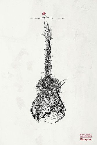 Guitar roots into rose or maybe a small tree tattoo in