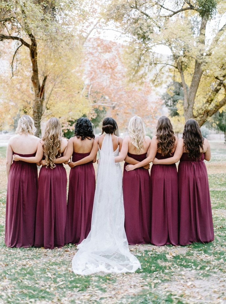 Burgundy bridesmaid dresses + Bride in lace wedding dress | fabmood.com #fallwedding #weddingdress #burgundy #wedding