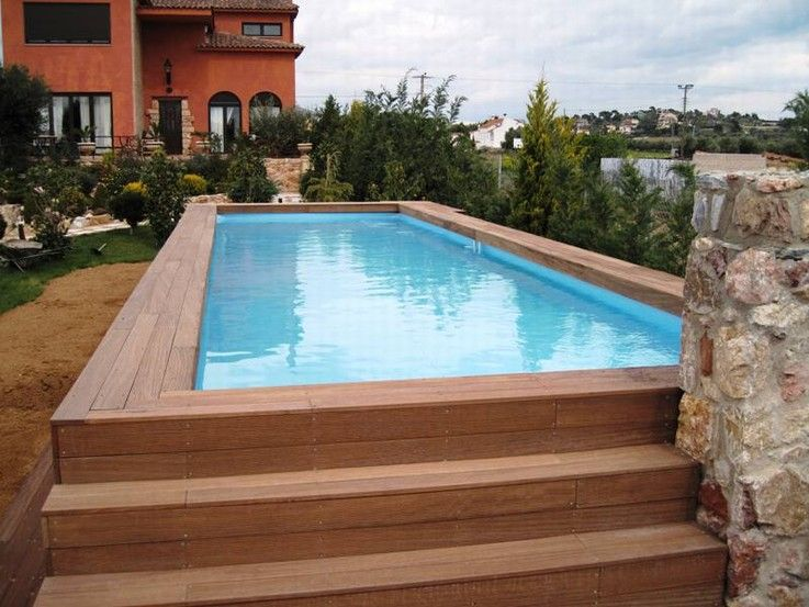 swimming pool rectangular above ground pool with wooden steps deck surrounded by beautiful backyard garden