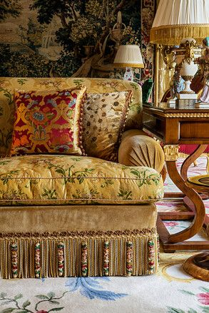 A room in a house in Kuwait, featuring a range of Alidad's bespoke textile designs. 'I like mixing patterned and plain fabrics,' says Alidad, who combined richly patterned silk on the sofa cushions with plain velvet on the sofa's arms and base. He incorporated handmade fringe by Jane Brighty, director of Smith and Brighty, a London firm specializing in tassels and trimming.