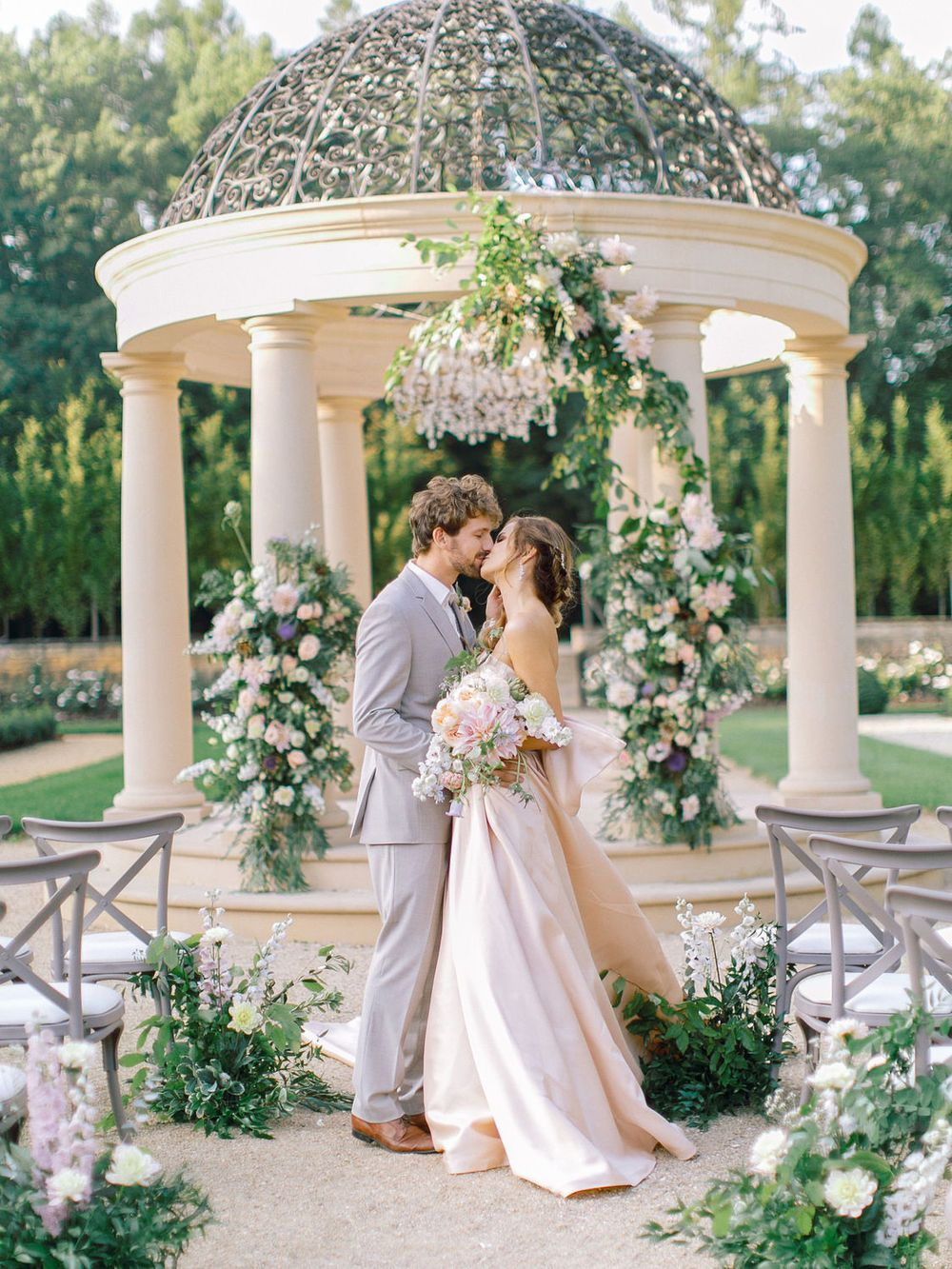 b62ff0ef342 garden gazebo wedding with a strapless blush wedding dress and light gray  groom suit