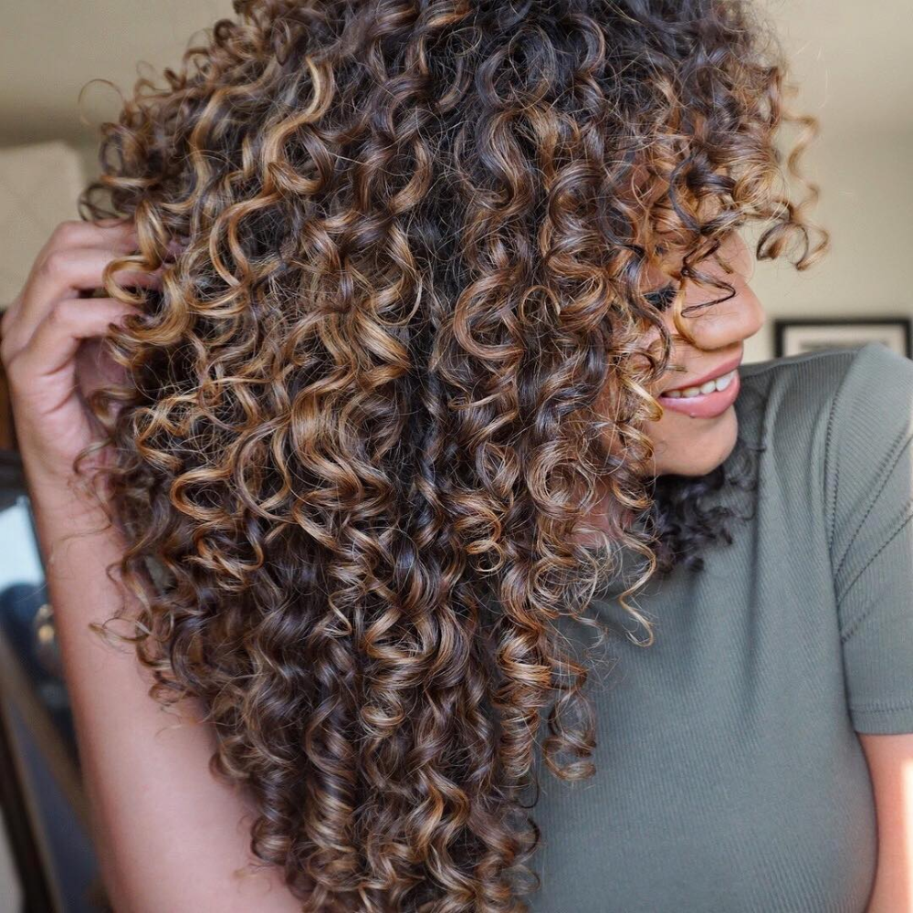 Melted Caramel Highlights Tie In Pale Brown With Flecks Of Gold And Gingerbread And They Re T Curly Hair Styles Naturally Curly Hair Styles Curly Hair Photos