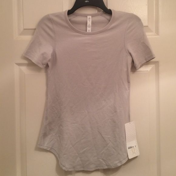 Lululemon Inner Essence SS tee 4 New with tags. S I S color is a silver gray. Size 4. No trades please! lululemon athletica Tops Tees - Short Sleeve