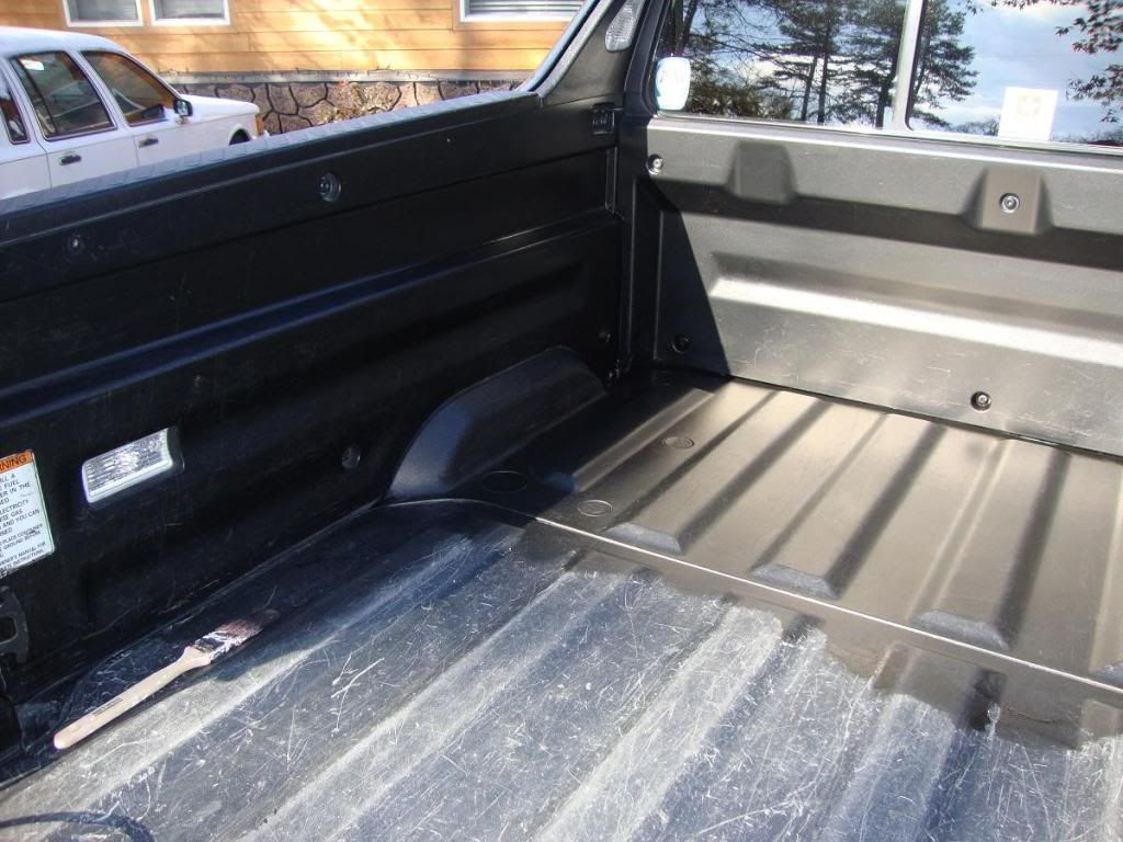 Use bondo restore black to remove scratches from truck bed