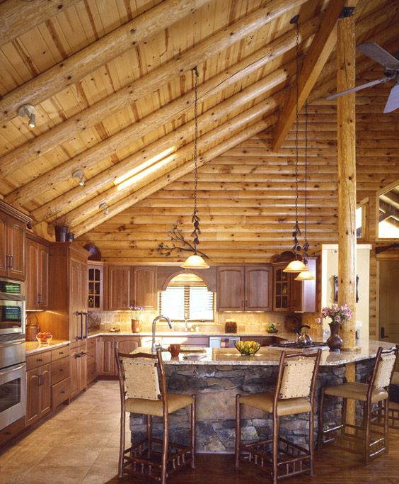 Log Home Kitchen With Cathedral Ceilings And Stone Work