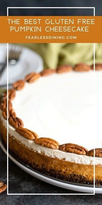 You are going to LOVE this creamy gluten free pumpkin cheesecake recipe. Bourbon pumpkin cheesecake makes a delicious dessert for Thanksgiving or any holiday. Simple step by step directions. Recipe at www.fearlessdining.com #pumpkin #glutenfree #cheesecake #pecan #holidaycake #pumpkincheesecake