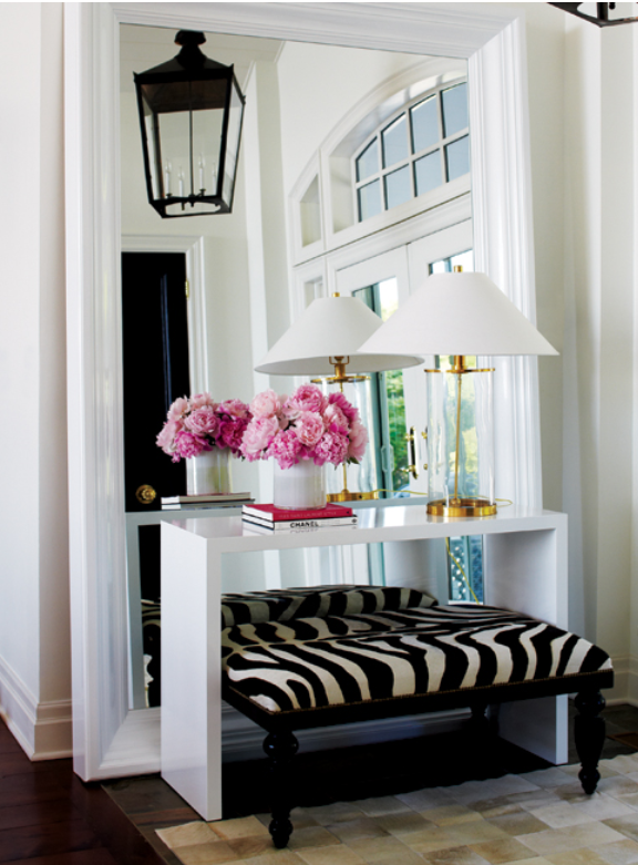 Perhaps a bit glamorous but love the idea of a large mirror
