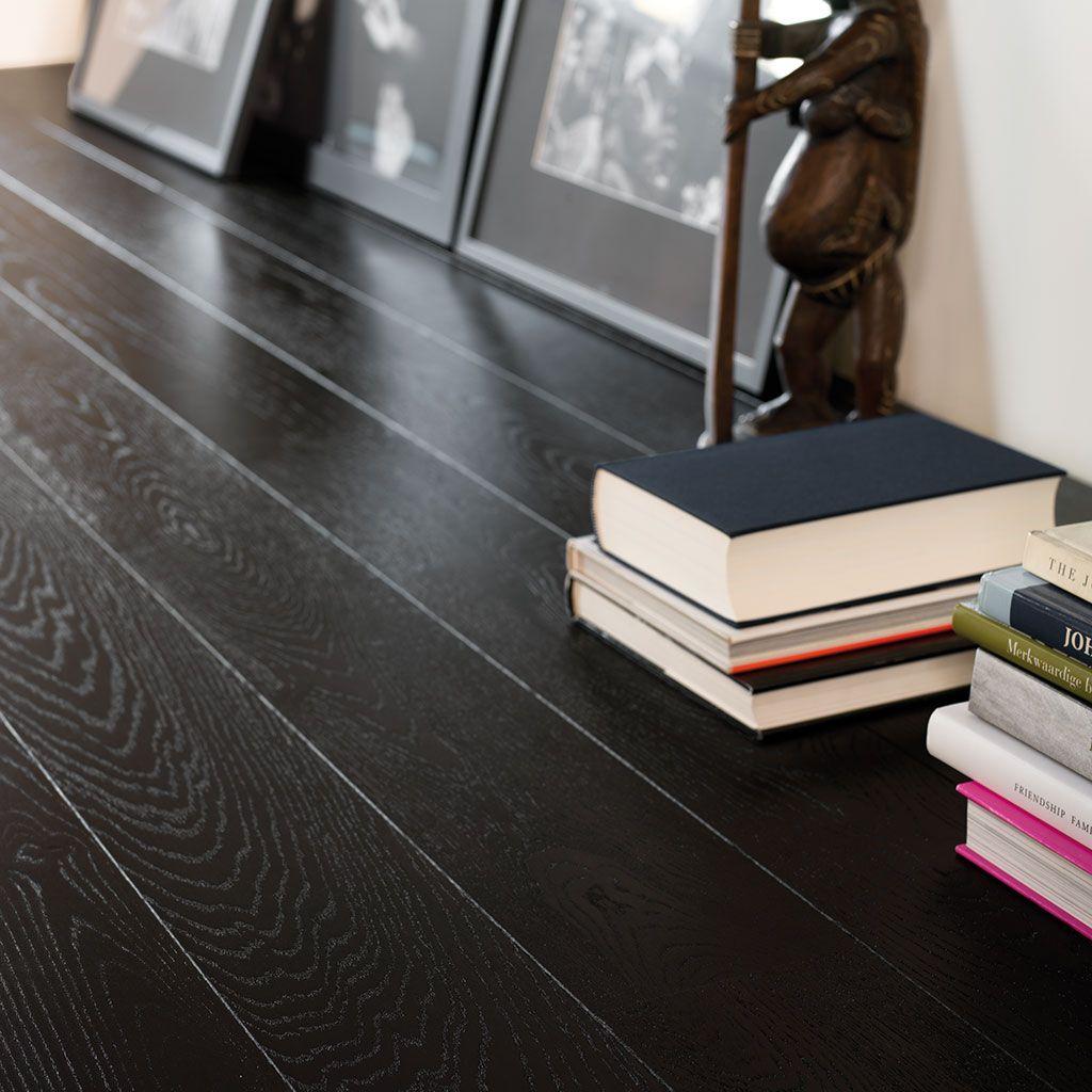 Quick-Step Hardwood Flooring - Castello 'Wenge oak silk' (CAS1343) in a modern living room. To find more living room inspiration, visit our website: https://www.quick-step.co.uk/en-gb/room-types/choose-the-perfect-living-room-flooring #salon #woonkamer