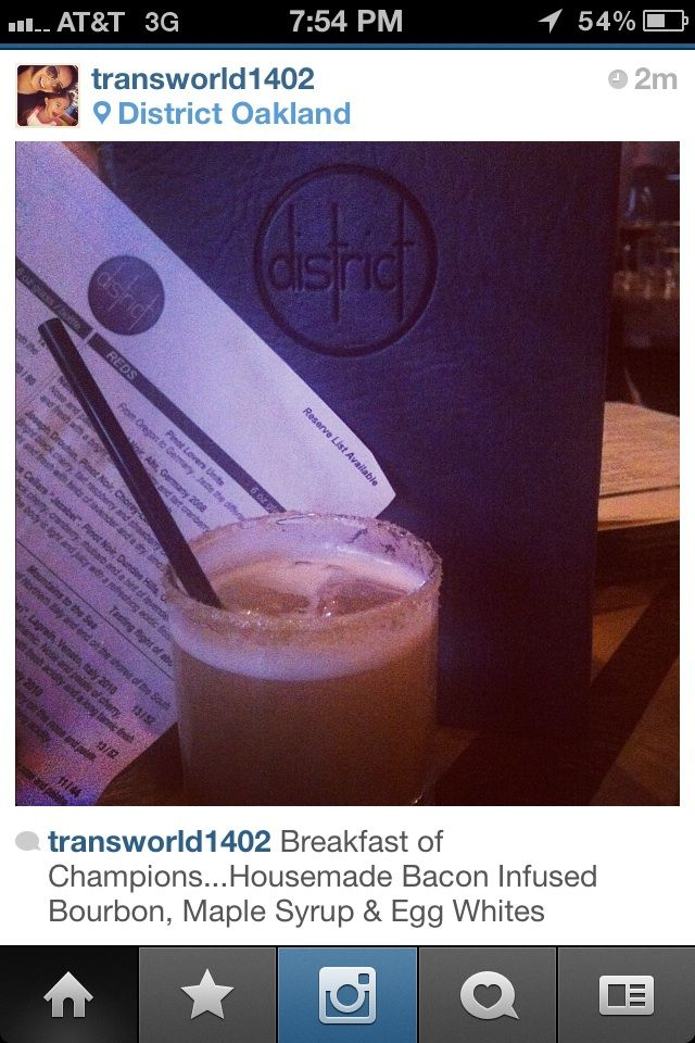 """Yum, liquid breakfast for dinner! Tran enjoyed a tasty """"Breakfast of Champions"""" at District's soft opening in SOMA. Bacon infused bourbon, egg whites, and maple syrup...what better way to end the day?"""