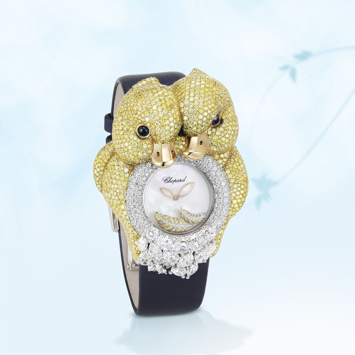 Caressed by a black silk bracelet, two yellow diamonds ducklings snuggle on the diamond-set case of this sweet watch.
