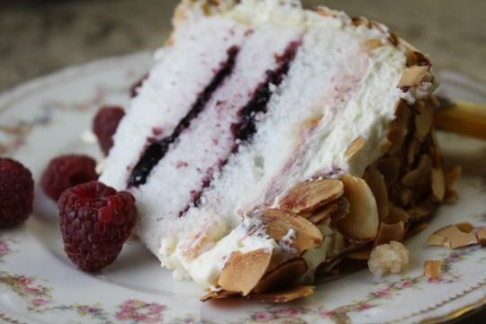 SPECTACULAR ANGEL CAKE WITH BERRY FILLINGS, WHIPPED CREAM FROSTING and toasted almonds. OMG. Make for a special occasion. Not all that hard, really.