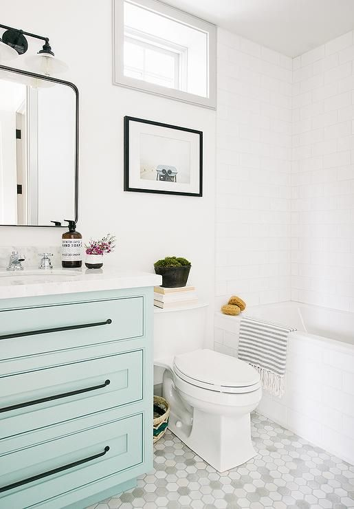 Marble hex floor tiles frame an aqua blue washstand accented with ...