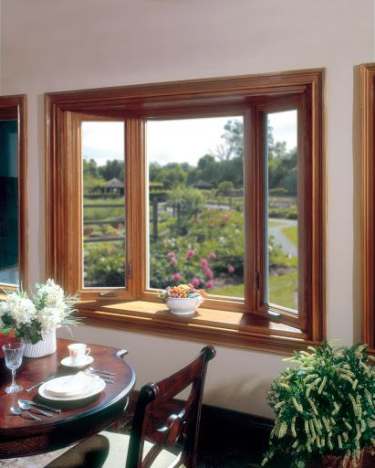 Vinyl bay window creates depth and room and has the appearance of real wood, also available in other colors