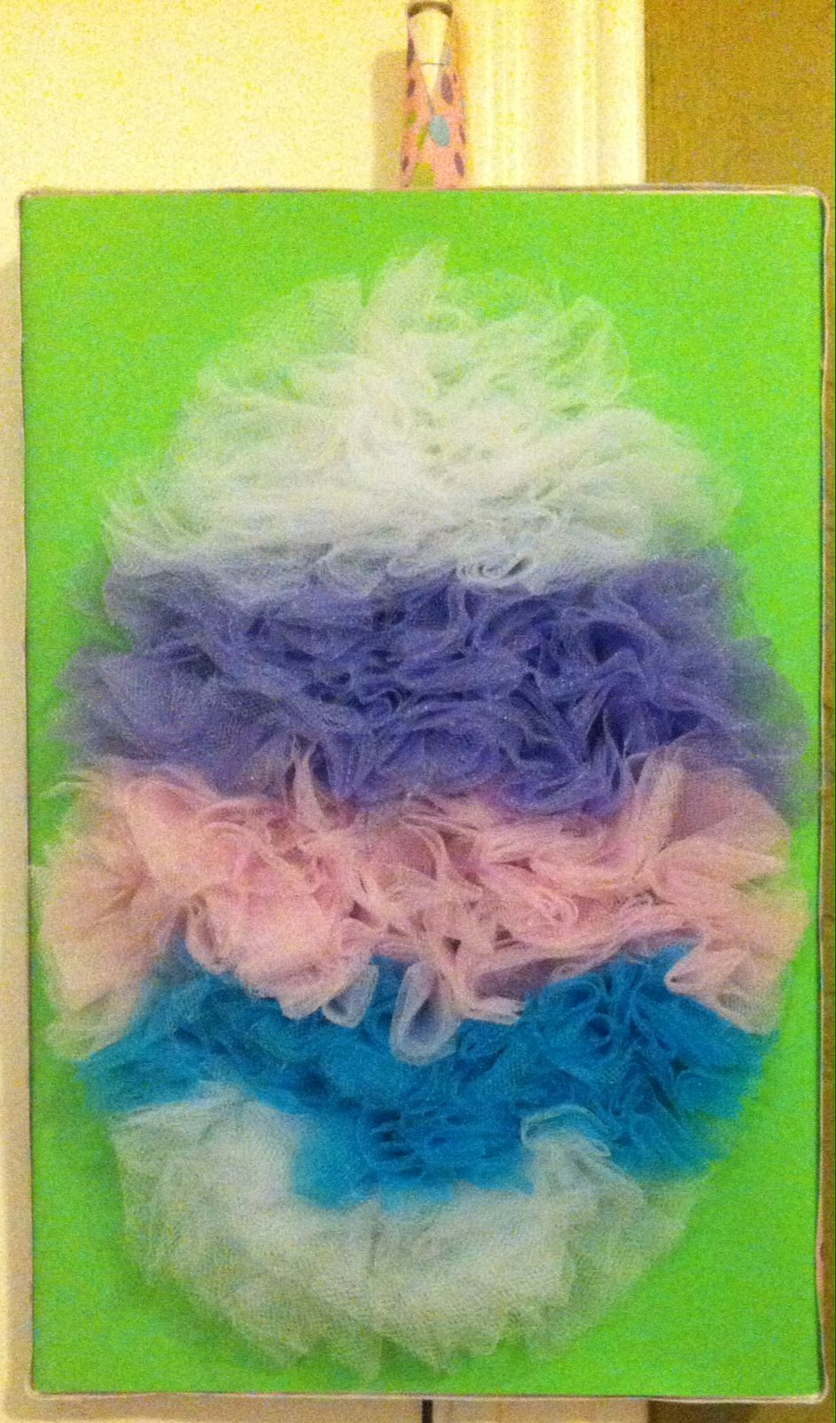 Tulle easter egg to hang on office door egg shape outlined on paper