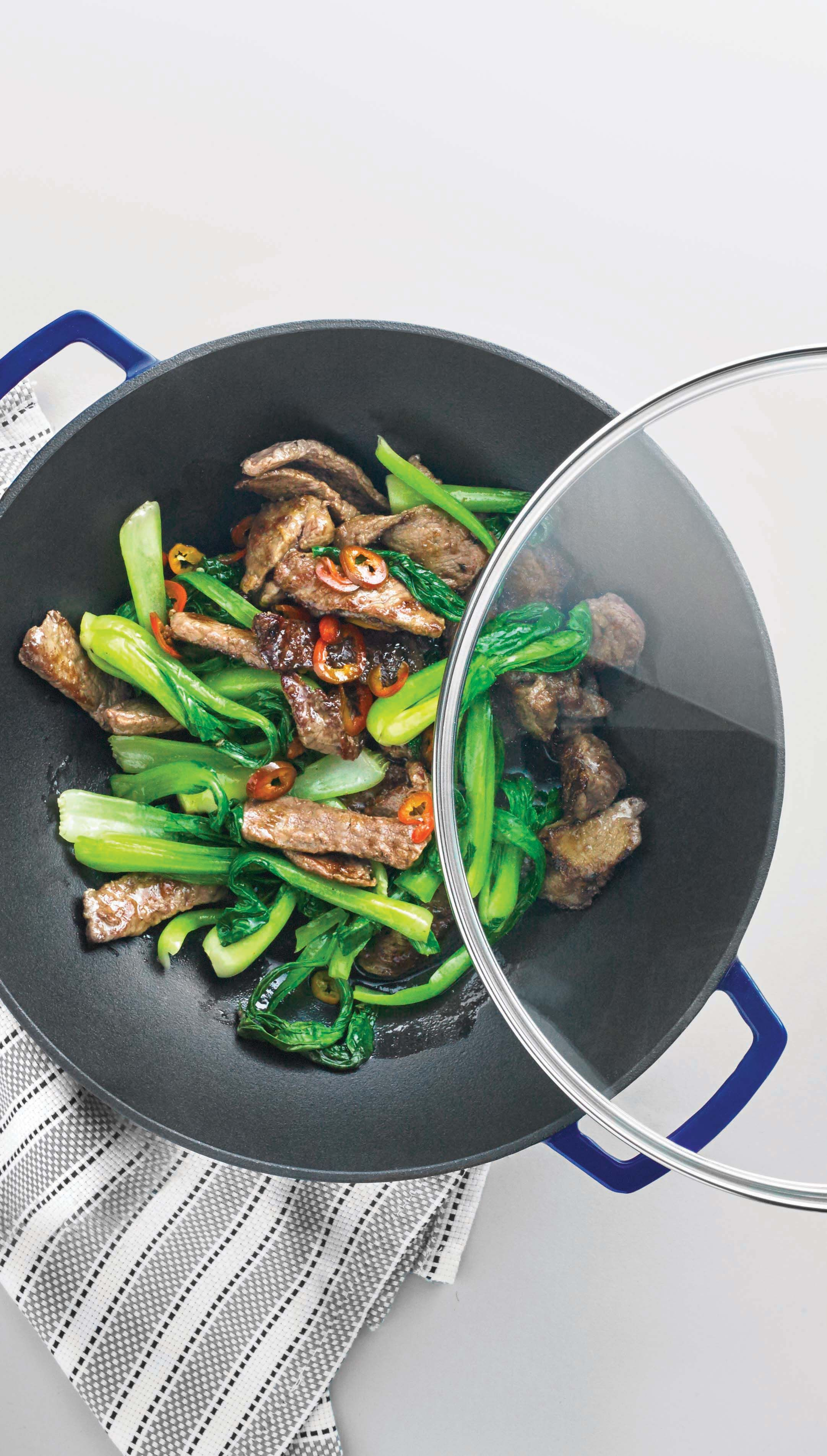 Looking for a healthy and fast weeknight dinner? The round bottom and high sides on Martha's wok are designed to spread heat evenly and cook food quickly, making it perfect for stir-fry! Shop enameled cast iron cookware from the Martha Stewart Collection created for Macy's!