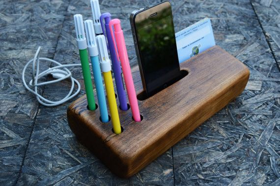 Wooden iPhone station, wooden organizer. Handmade from gorgeous recycled beech wood. The stand fit to iPhone 4, iPhone 5 and phones with similar sizes.  Size approximately: Length: 24cm (9.36 in.) Width: 11cm (4.29 in.) Height: 4.5cm (1.75 in.)  Add a touch of nature to your workspace or home with a natural wooden iPhone Station.