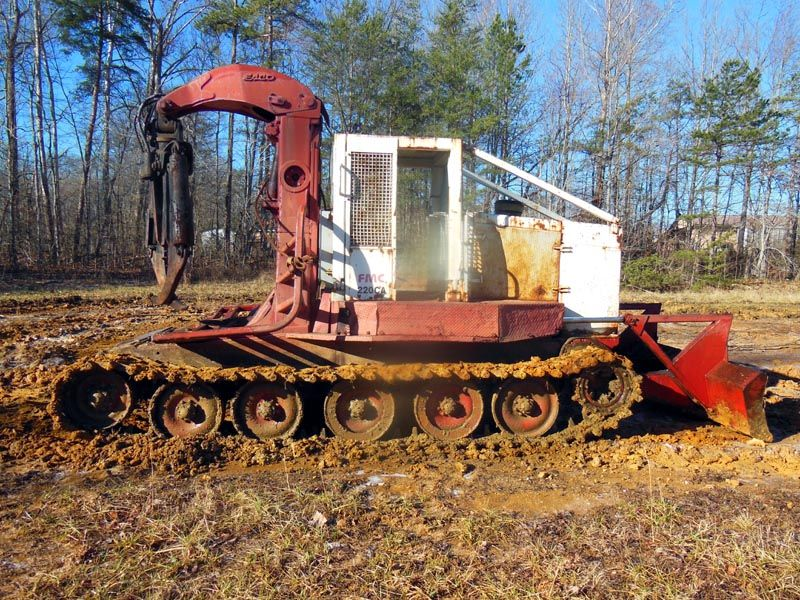 old logging machinery FMC 220AG Track Skidder. Grapple