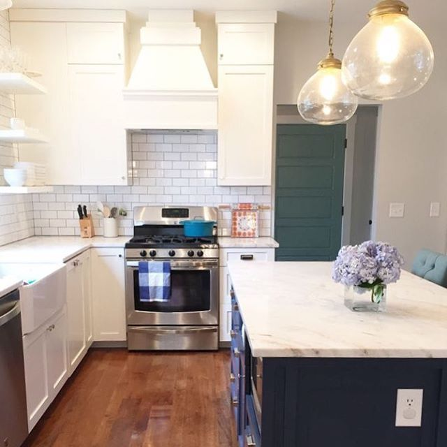 Subway Tile Backsplash In This Gorgeous Kitchen With A Farmhouse Sink, White Cabinets, And A