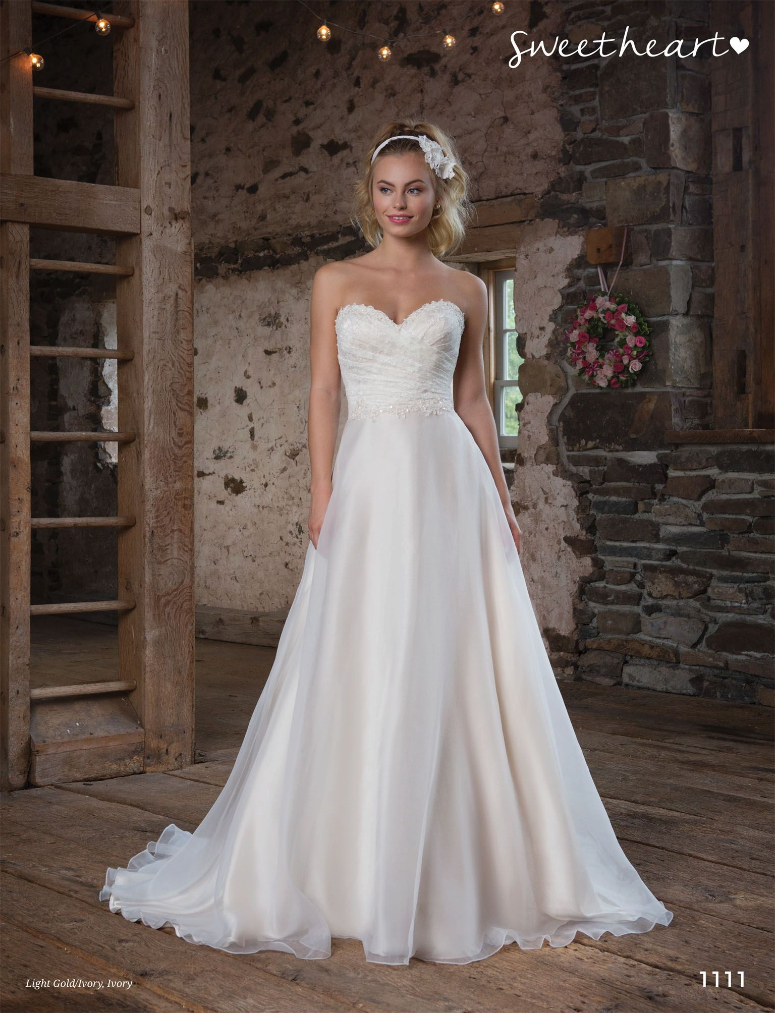 Sweetheart style girly details highlight this ball gown a
