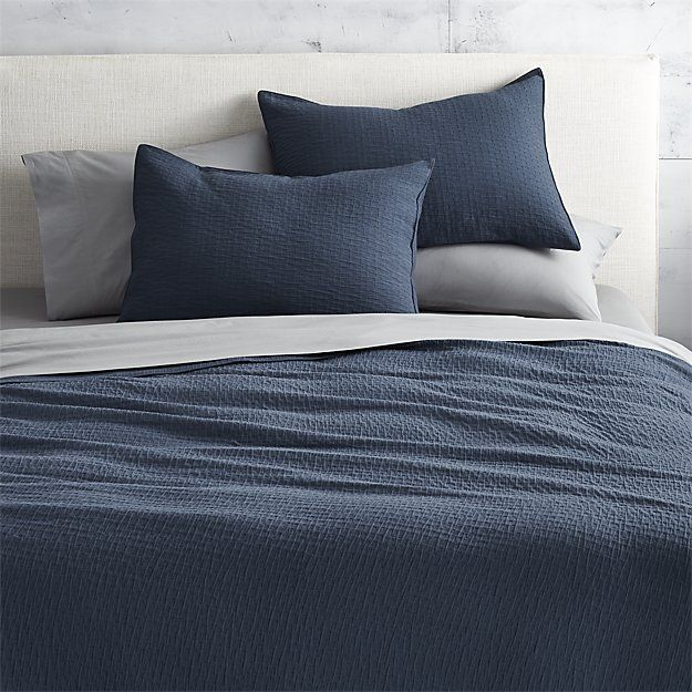 Shop lilo navy bedding.   Waves of navy texture cozy up in traditional Portuguese 100% cotton matelasse bed linens, intricately woven on a jacquard loom.