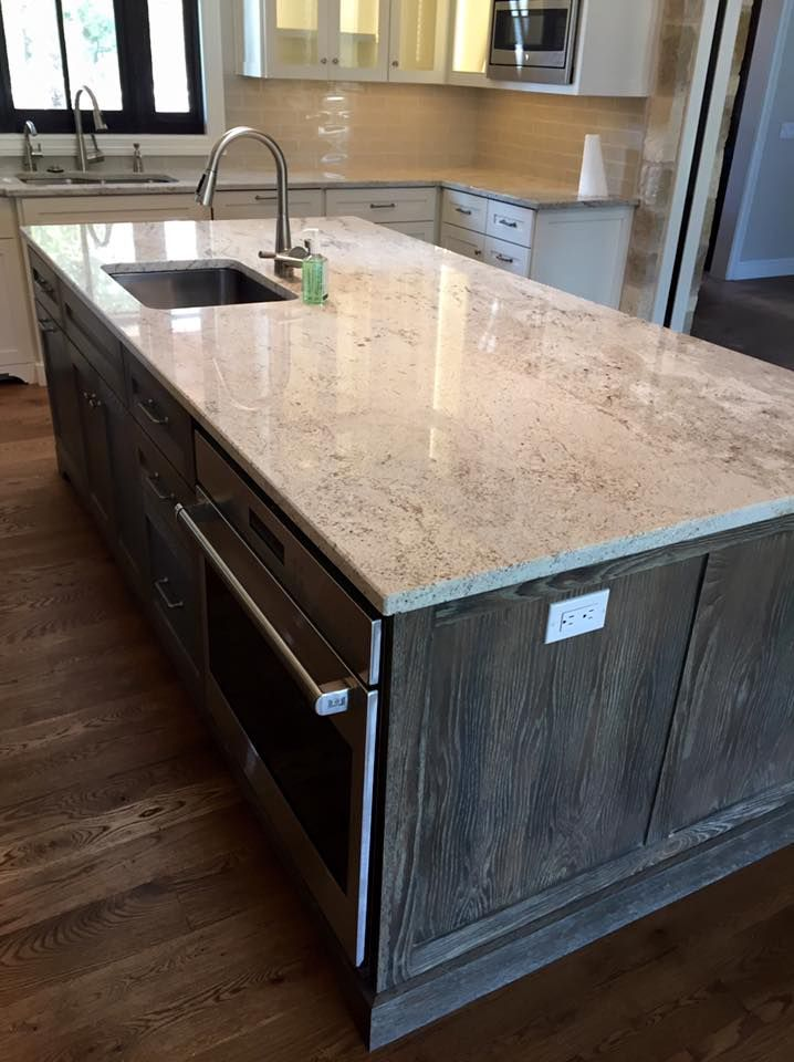 Light granite river white granite kitchen island for Pictures of white kitchen cabinets with granite countertops