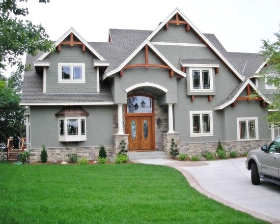 Traditional exterior charcoal gray design pictures for Houses with stucco and siding