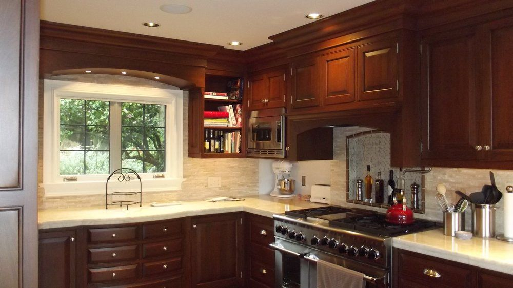 rutt cabinetry cherry kitchen the 7 drw cabinet below the window curved front and valance 3