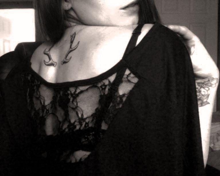 Antler neck tattoo