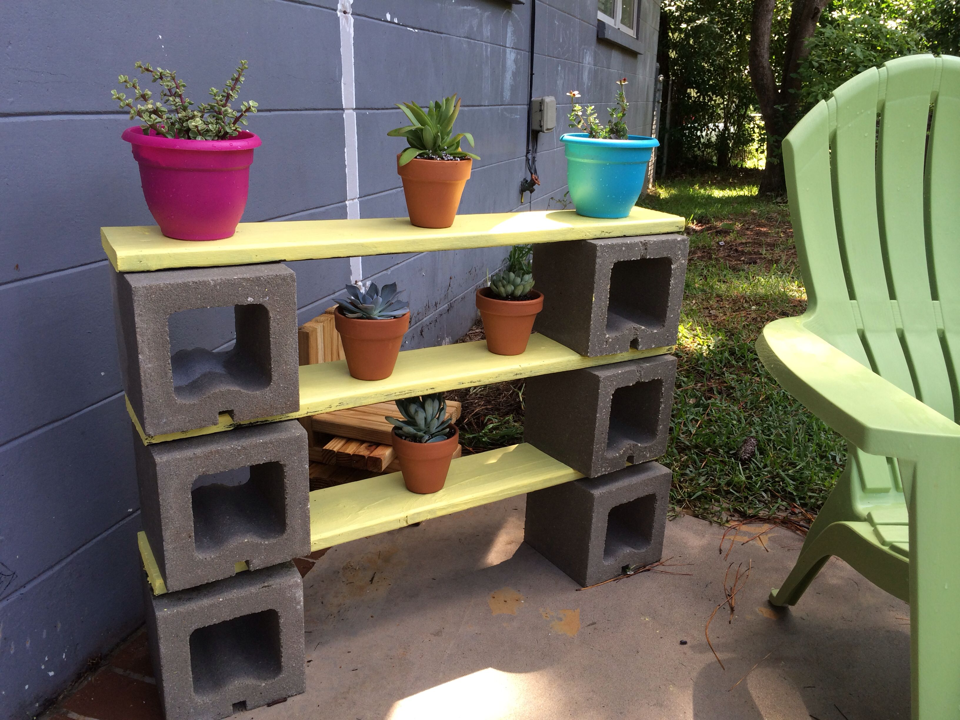 Scrap wood and cinder block plant shelves back for Cinder block plant shelf