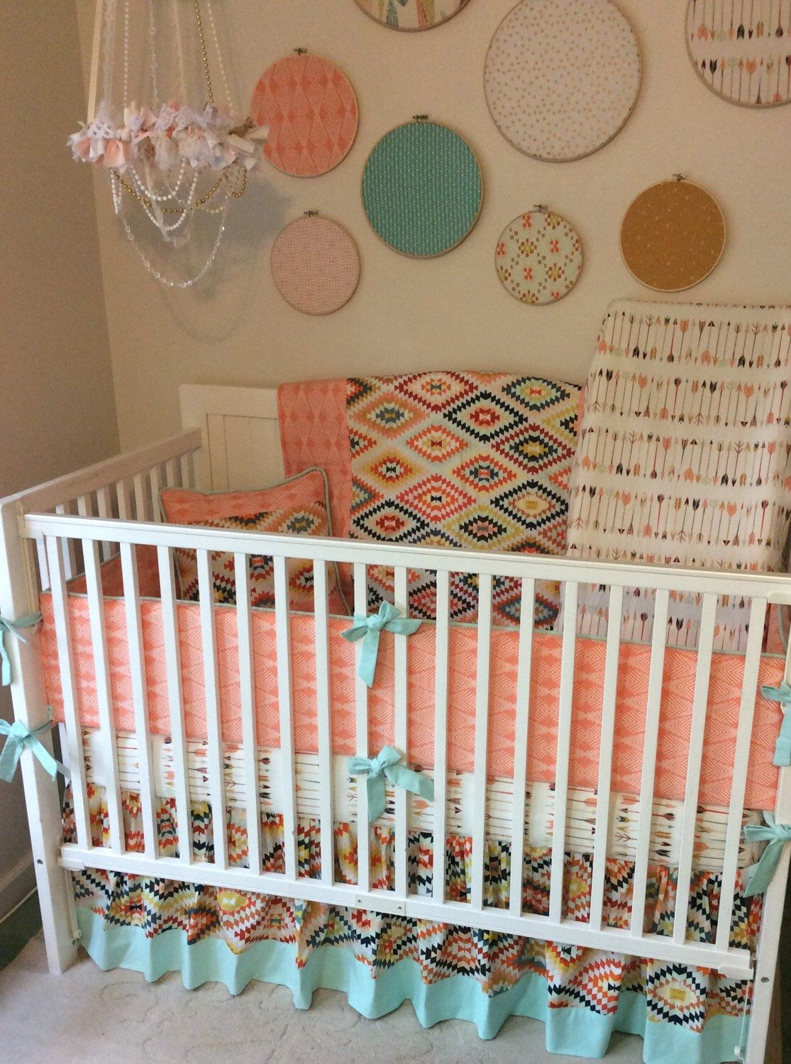 Aztec baby girl bedding in peach mint and gold with arrows Baby girl bedding