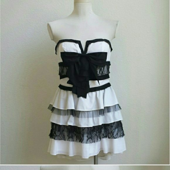 Gorgeous BeBe dress M cocktail/formal/prom Like new black and white bebe dress with bow on front and zipper in back. Size M. Beautiful for any formal occasion or as a cocktail dress. bebe Dresses Mini