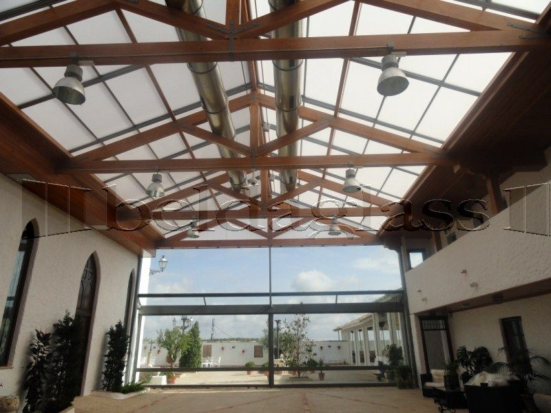 terraza patio cubierta con techo movil de cristal techos