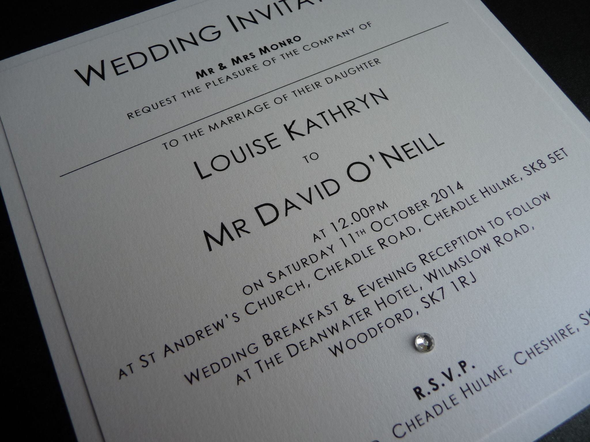 Simple white mounted wedding invitations using pearlised